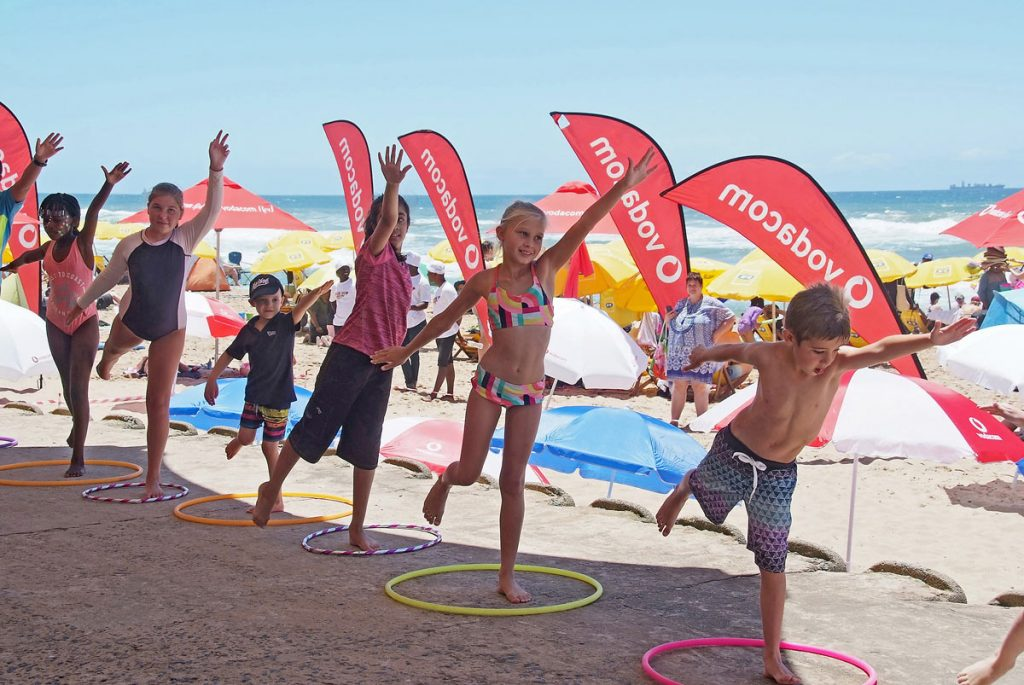 FEATURED IMAGE: Kids enjoy the mini-fun olympics on the Millennium Stage during the Umhlanga Summer Festival on Monday, 16 December. All photographs by ROY REED